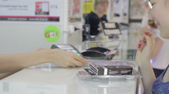 Girl makes a purchase at the accessories store Stock Footage