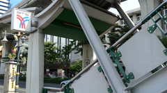 Guy walks at the stairs towards Phrom Phong BTS Station Stock Footage