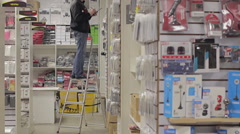 Man holds an inventory of equipment in the shop Stock Footage