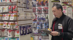 Shopkeeper holds an inventory of equipment in the shop Stock Footage