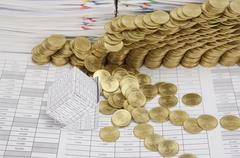 Close up bankruptcy house have gold coins collapse - stock photo