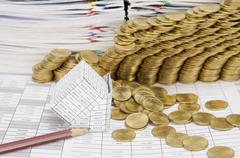 Close up pencil and bankruptcy house have gold coins collapse - stock photo