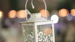 The top part of a white lantern hanging in a wedding ceremony. - stock footage