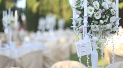Wedding decorations. White, floral centerpiece candlestick on wedding banquet. Stock Footage