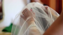 Putting the bride's white veil on the hair of the bride. - stock footage
