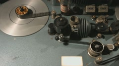 Stock Video Footage of Overhead tracking shot of an old film editing equipment