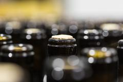 wine bottles on the conveyor - stock photo