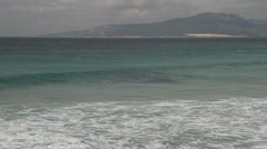 Ocean beach in Tarifa, Spain, sand, beach, waves, resort - stock footage