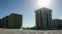 Hotel / Condo on beach with sun Stock Footage