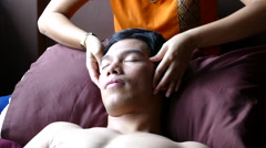 Guy gets a head massage in Bangkok Thailand Stock Footage