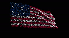 American flag waving in wind, consisting set of hands. - stock footage
