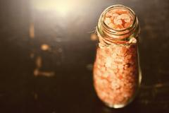 Pink Salt Crystals in a Glass - stock photo