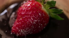 Strawberry rotating on chocolate slow motion - stock footage