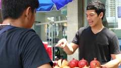 Guy orders pomegranate juice (Nam tub-tim juice) at at Silom road Stock Footage