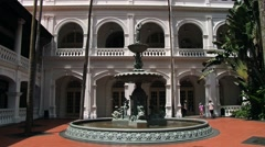 Fountain in front of the Raffles hotel historical building in Singapore,. Stock Footage