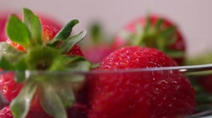 Fresh strawberries rotating with sunlight. Stock Footage