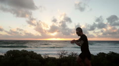 Silhouette of man running  at the beach slow motion Stock Footage