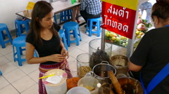 Girl Ordering som tam, Isan food at Lalai Sap Market in Silom Bangkok Stock Footage