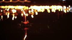 Loi Krathong festival in Thailand, floating basket flowers on river full moon Stock Footage