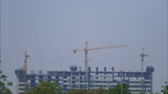4k Time-lapse of Building construction with Crane at construction site Stock Footage