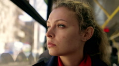 Young woman traveling by bus on a sunny day Stock Footage