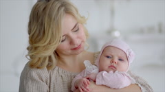 Sleeping baby on the mother's hands. Young mother shakes her baby in her arms. - stock footage