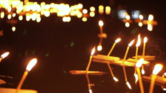 Stock Video Footage of Loi Krathong Festival in Thailand. Hand releasing floating decorated baskets
