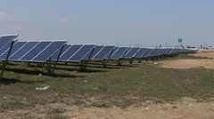 Solar panels with the sunny sky. Blue solar panels. background of photovoltaic m Stock Footage