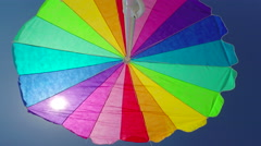 Low angle colorful beach umbrella Stock Footage