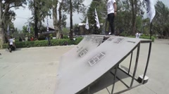Skateboarder performing tricks at Burnham Park, Baguio Stock Footage