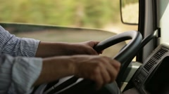 Man holding steering wheel while driving big truck. Stock Footage