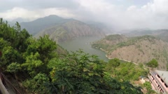 View of Ambuklao Dam river reservoir in summer day Stock Footage