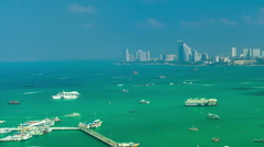 Time lapse video of tropical city shore with boats - stock footage