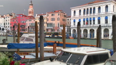 Venice canal near Rialto bridge during bad rainy weather - stock footage
