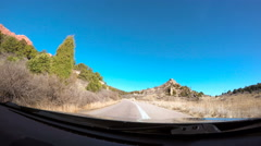 View from the dashboard camera while driving through Garden of the Gods. Stock Footage
