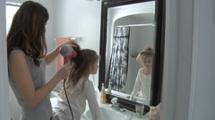 Mother Fixing Daughters Hair In Bathroom Stock Footage