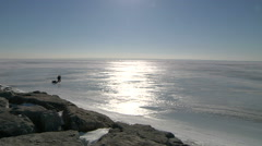 People Going Ice Fishing On Frozen Lake - stock footage