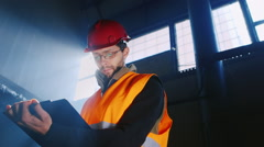 Builder works with documents Stock Footage