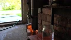 Homemade distillery equipment heat on fire and final hooch product. 4K Stock Footage