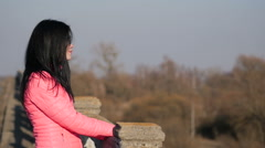 Girl posing on the old bridge Stock Footage