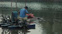 Farmer on his raft feeding the shrimps Rec709 Stock Footage