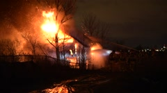 Barn Fire Wide Heavy Flames With Firefighters Stock Footage
