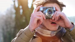 Young well dressed business man takes a photograph Stock Footage