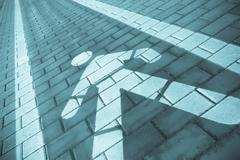 perspective view for a pedestrians lane along a sidewalk, cyan effect - stock photo