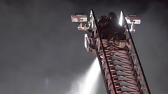 Firefighter Spraying Water From Top Of Aerial Stock Footage