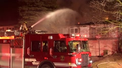 Firefighter Spraying Water From Monitor on Truck Stock Footage