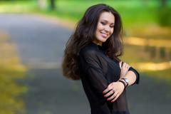 Beautiful latinonos woman in casual wear  walking on the park. Fashionable gi - stock photo