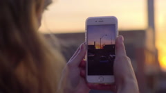 Closeup Of Teen Using Smartphone To Take A Video Of A Beautiful Sunset In City Stock Footage