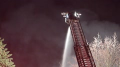 Firefighter Spraying Water From Top Of Aerial Wide Stock Footage