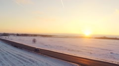 Winter road. Aerial footage. White fields covered with snow. Sunset. - stock footage